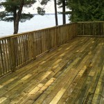 pressure treated deck built on rock face