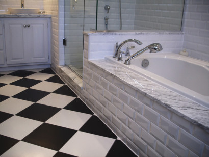 white subway tile on walls, black and white floor checker