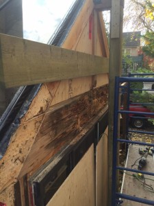 side view of rotted beam before replacement