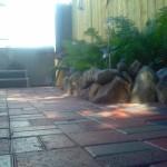 back yard red brick patio beside hot tub