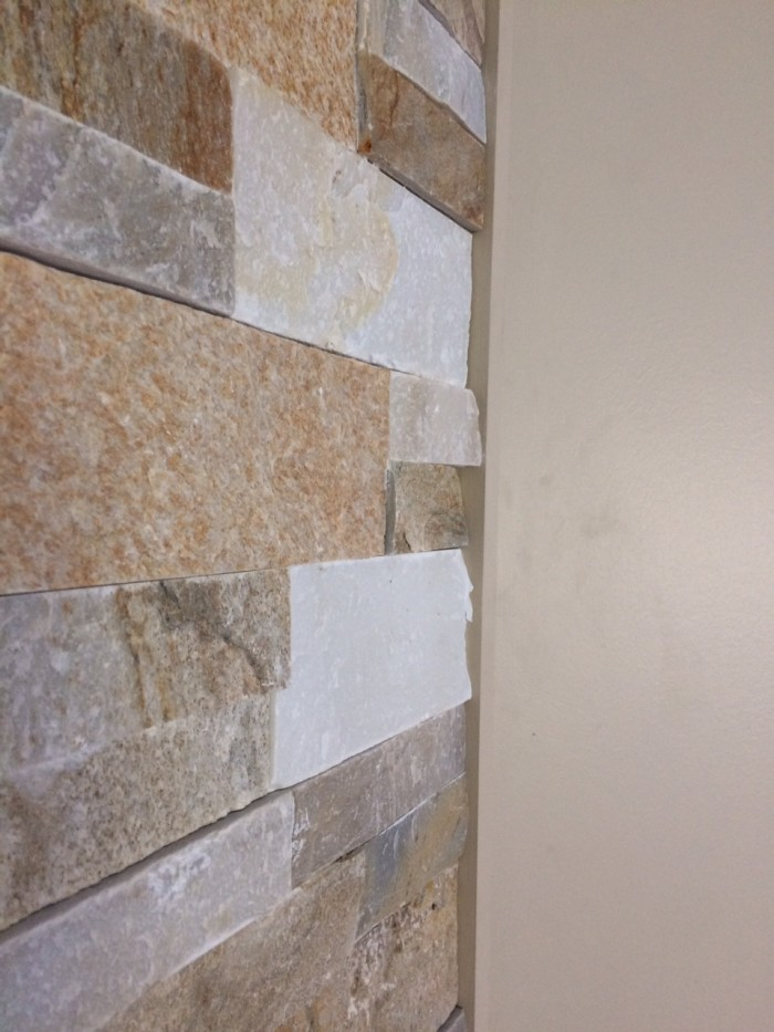 side view of stone on wall