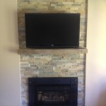 modern entertainment centre with stone wall