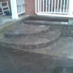 Front interlocking grey stone with garden